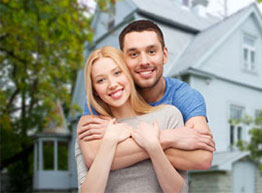 Home Insurance - Couple in Front of House